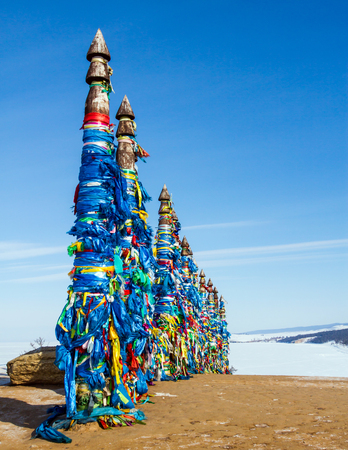 shamanism: Shaman sacred place on lake Baikal. Ritual pillars on the island.
