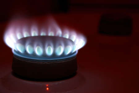 Lighted burner on a gas cooker on a dark background  photo