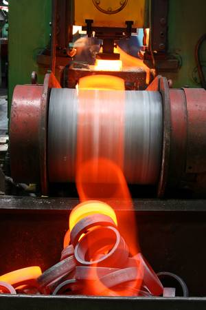 Preparations for bearing with red-hot metal falling from the moving conveyor Stock Photo