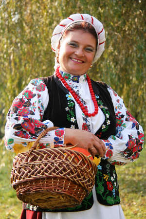 A woman in Ukrainian national costume with a basket on his arm Stock Photo