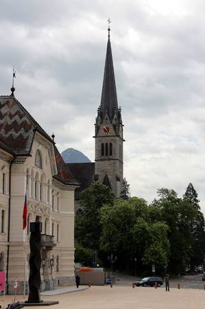 The square in front of Vaduz town hall, Liechtenstein. The background Cathedral. Stock Photo