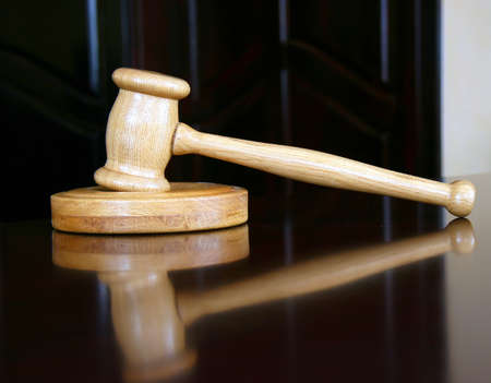 Wooden justice gavel and sound block photo