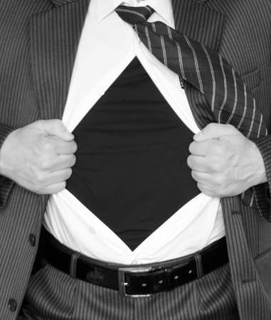 Cropped view of frustrated businessman tearing off his shirt