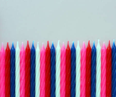Row of birthday candles red white and blue  photo