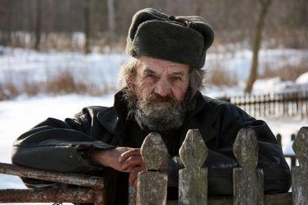 Portrait of a elderly man in winter hat