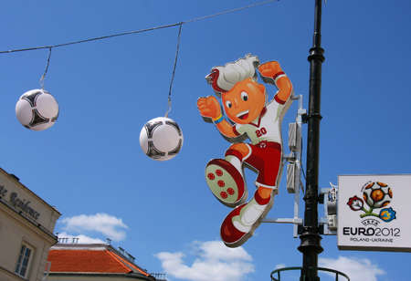 Warsaw, Poland - May 25, 2012 - Mascot figure Slavek, the UEFA Euro 2012 in street column
