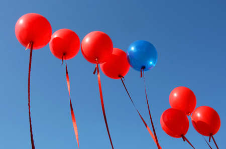 Balloons red and blue against the sky photo