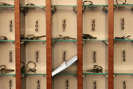 Several hotel keys in a cabinet Stock Photo