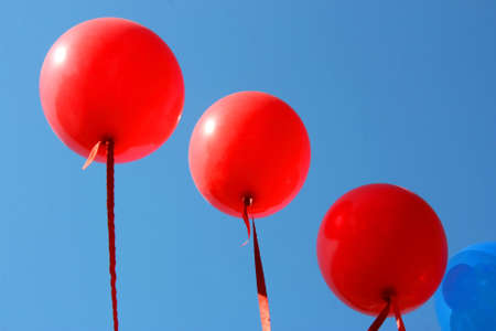Red balloons against the sky photo