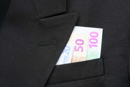 breast pocket: Money in a breast pocket of a jacket