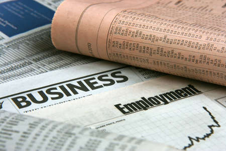 job market: Newspapers: everyday searching for job and business opportunities Stock Photo