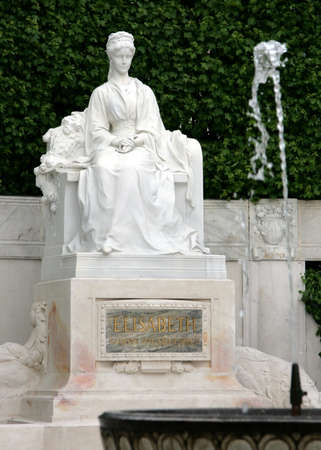 Monument for Empress Elisabeth and fountain before it in the city park in Vienna Austria Stock Photo