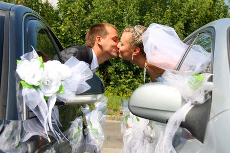 Passionate married couple kissing with car windows