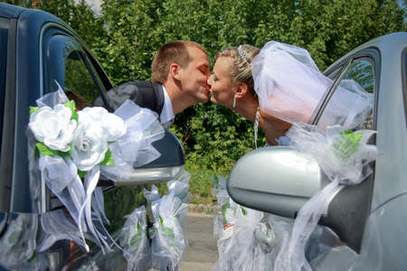 Passionate married couple kissing with car windows photo