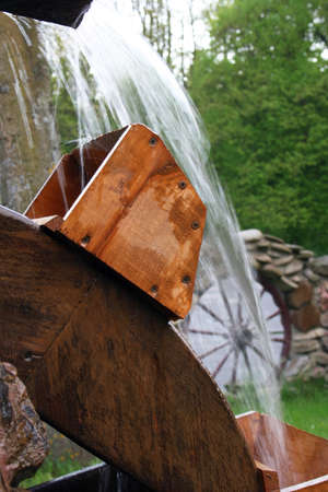 old grist mill: Wooden wheel of an ancient water mill