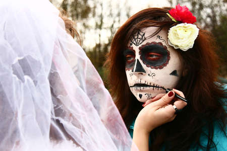 Woman makes a Halloween make-up wearing Day of the Dead Stock Photo - 16443561