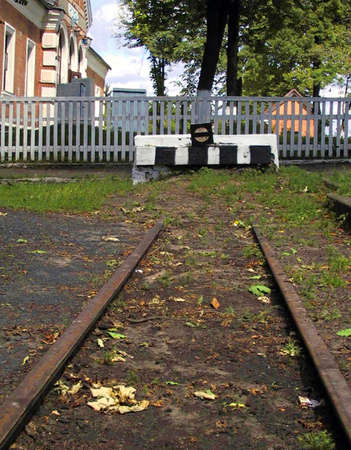 deadlock: The end of the railway deadlock, to the back portion of the fence and the station