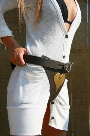 Chastity belt on a woman in white dress Stock Photo