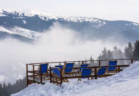 Sunbeds in the mountains at a ski resort Bukovel, Ukraine