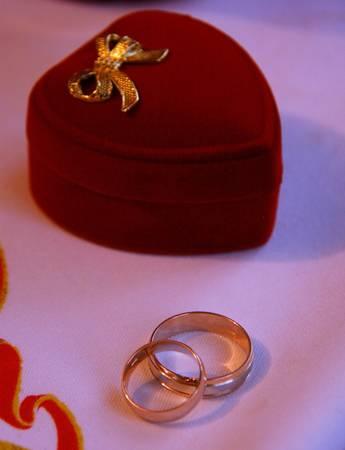 Two wedding rings near nice red box Stock Photo