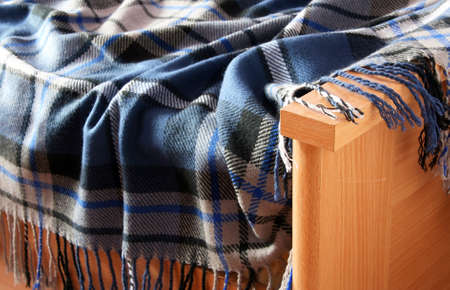 Plaid blue lie on a wooden bed Stock Photo - 22215891