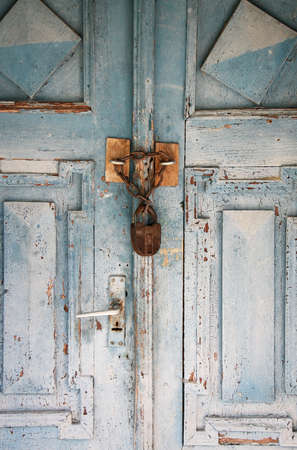 Locked old wooden door photo