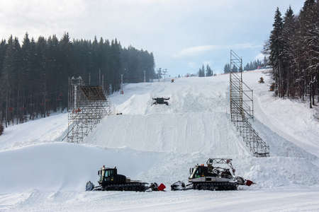 snow grooming machine: Snow-grooming machine on snow hill ready for skiing slope preparations in Ukrainian Carpathian