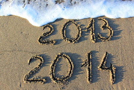 Happy New Year 2014 replace 2013 concept on the sea beach  photo