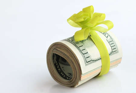 U S  dollars banknotes with a green ribbon as a gift of money