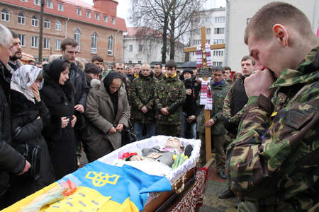 clashes: LUTSK, UKRAINE - February 23, 2014: memorial service at Cathedral on 21 year old Euromaidan activist Vasyl Moysey who was killed in Kiev clashes with riot police on Hrushevskoho st