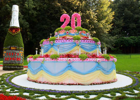 forthcoming: KIEV, UKRAINE - AUGUST 23: The festive cake devoted to forthcoming 20th anniversary of Ukraine Independence made of flowers at the 56th annual flower exhibition on August 23, 2011 in Kiev, Ukraine.