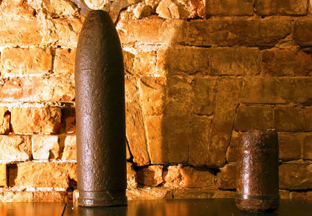 artillery shell: A very old cannon projectile quite rusted Stock Photo