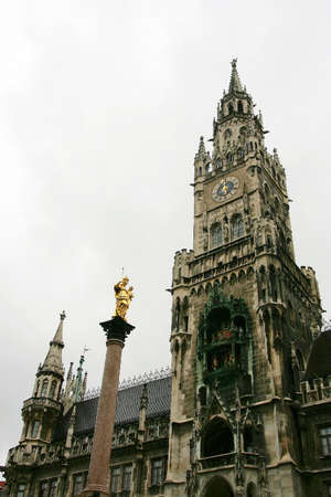 neues: The facade of Neues Rathaus in Munich  in cloudy weather