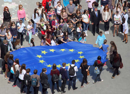 mobs: Lutsk, Ukraine - May 17, 2014: young people holding a big flag of European Union during Europe Day