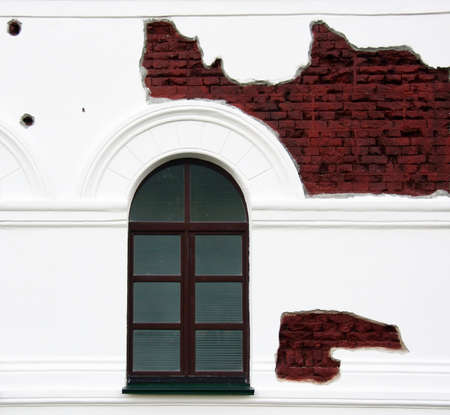 shelling: Window and fragment building walls with traces of shelling