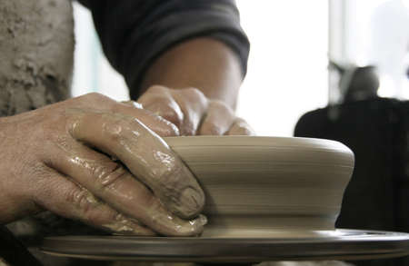 Hands of potter at work  Shallow depth of field  photo