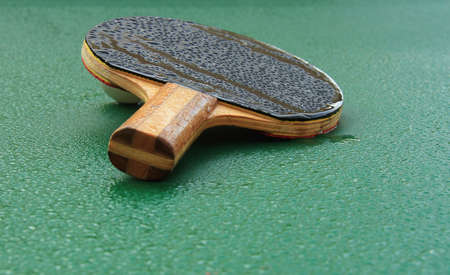 ping pong: Covered with dew racket for playing ping pong on a wet table