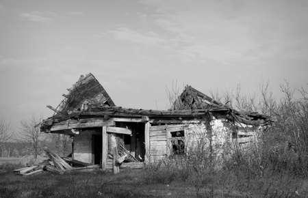 Abandoned house in a rural field in western Ukraine photo