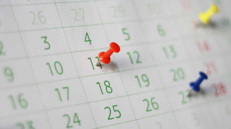 Close up calendar page with drawing-pins. Shallow depth of field.