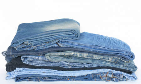 Stack of jeans on a white background Stock Photo