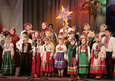 choral: LUTSK - JANUARY 23: Children choir performs in the theater at a charity concert to raise funds for orphans on January 23, 2015 in Lutsk, Ukraine.
