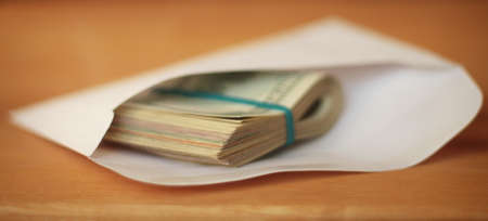 Cash in an envelope. Shallow depth of field. Stock Photo