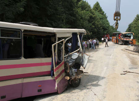 heartbreaking: KOVEL, UKRAINE - JULY 11: Scene of bus crash where nine Ukrainian, Belarusian and Bulgarian Tourists were died and as many as 30 others were injured July 11, 2013 just outside Kovel, Ukraine. Editorial