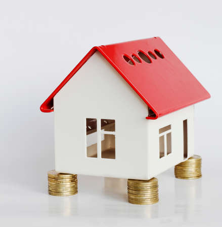 Mortgage concept by money house from coins 写真素材