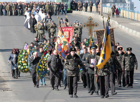 clashes: LUTSK, UKRAINE - March 23, 2015: Memorial service at Ukrainian army soldier who were killed by smugglers in checkpoint near the town Volnovaha Editorial