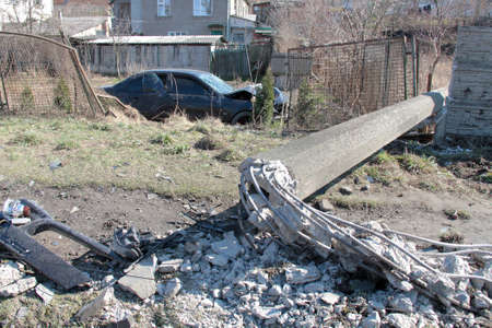 scrapheap: Smashed car in ditch and toppled pillar on-site accidents Stock Photo