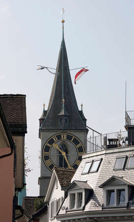 gabled: Top of St. Peter church and roofs of houses in Zurich Stock Photo