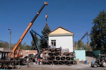 rebuilt: KRASNY LIMAN, UKRAINE - SEPTEMBER 06: Ukrainian workers rebuilt the railway station, destroyed separatists in the village Krasny Liman Donetsk region, Ukraine on September 06, 2014.