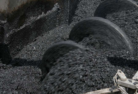 blacktop: Asphalt manufacturing equipment. Shallow depth of field. The effect of motion. Stock Photo