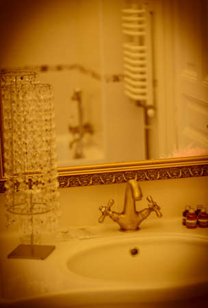 handbasin: Vertical view of washbasin in elegant bathroom. Retro effect. Stock Photo